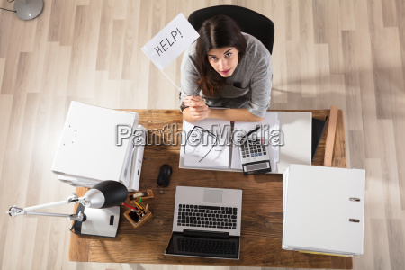 businesswoman showing help flag in office