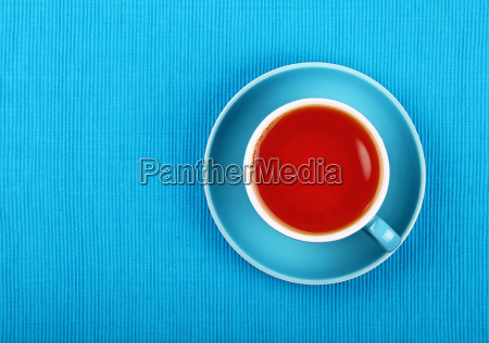 full black tea in blue cup