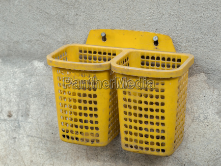 plastic basket screwed on concrete wall
