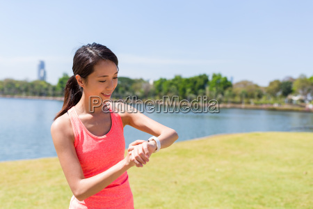 young woman using smart watch in