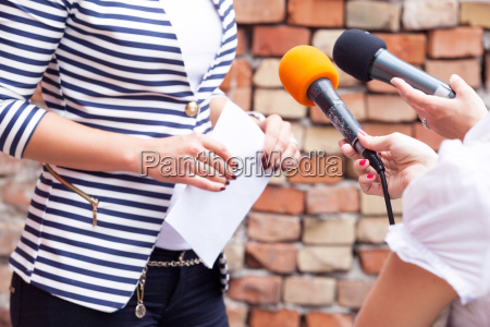press interview news conference microphones