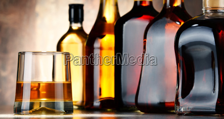 glass and bottles of assorted alcoholic