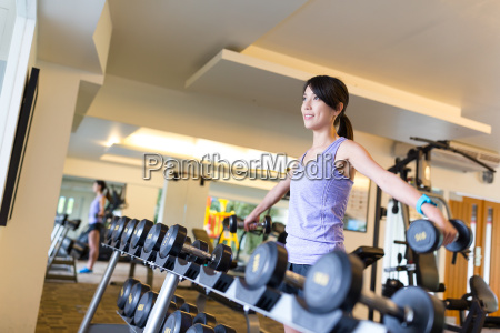 sport woman weightlifting at the gym