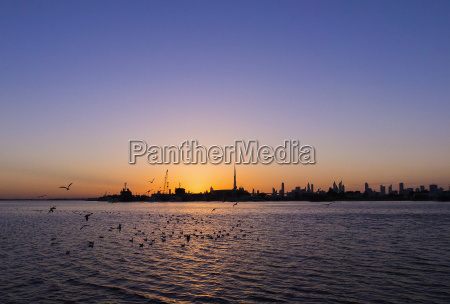 scenic view of silhouette city by