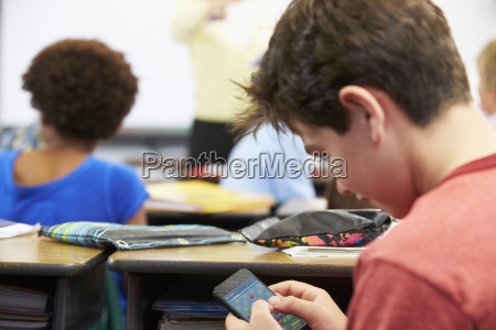 pupil playing a mobile game on