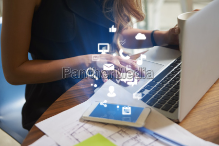 businesswoman working an office with mobile