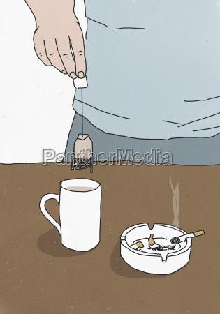 illustration of man holding teabag above