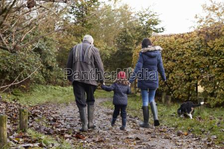 multi generation family take dog for