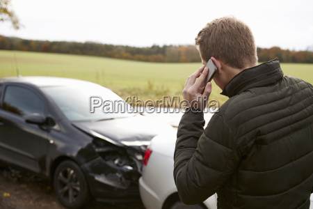 man calling to report car accident