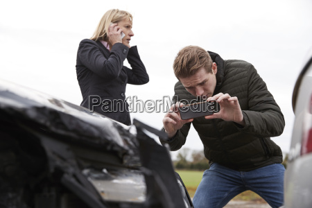 drivers taking photo of car accident