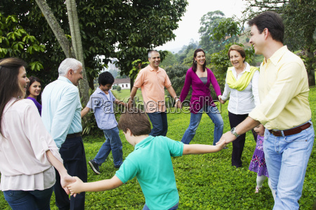 hispanic family holding hands in a