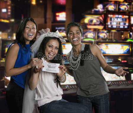excited women holding gaming voucher in