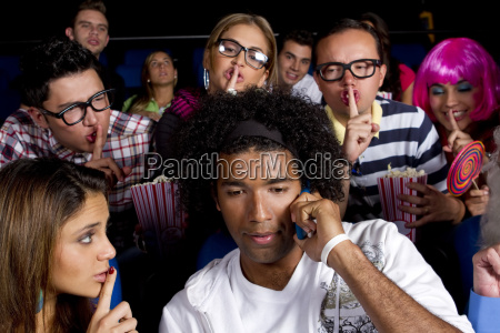 people quieting noisy person in movie