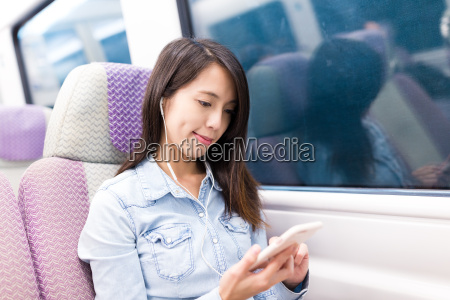woman taking express train and listen
