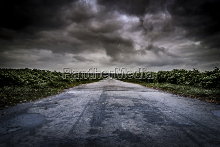 dirt road with dramatic cloudscape