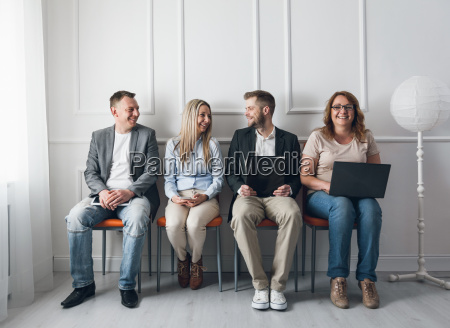 group of creative people sitting on
