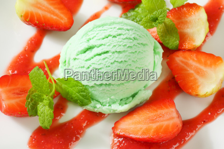 green ice cream with strawberries