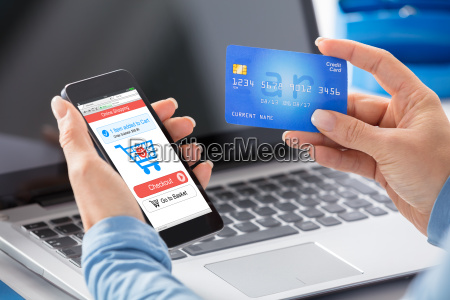woman doing online shopping using credit