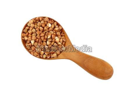 dried buckwheat groats in wood scoop