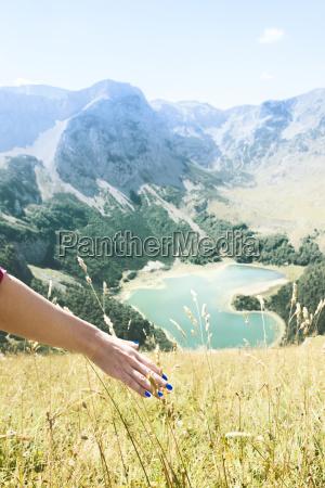 young womans hand and trnovacko lake