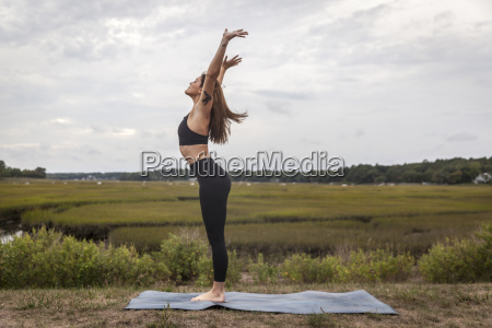 woman doing vinyasa outdoor yoga
