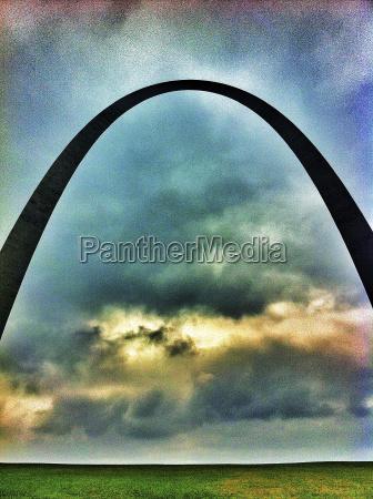 gateway arch against stormy sky st