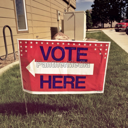 voting sign on lawn
