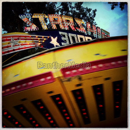 blurred view of spinning amusement park