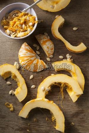 sliced munchkin pumpkins and pumpkin seeds