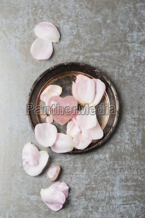 rose quartz with rose petals on