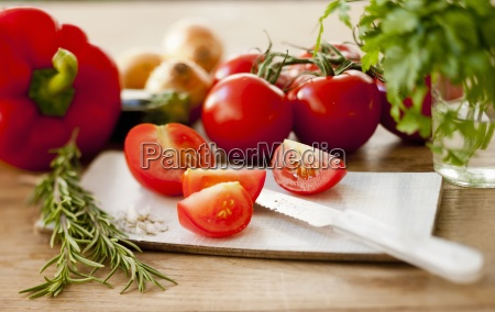 still life with tomatoes rosemary and