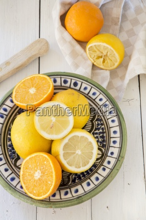 lemons and oranges on a ceramic