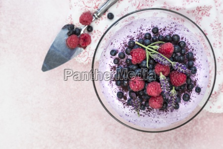 cheesecake with berries and lavender blossoms