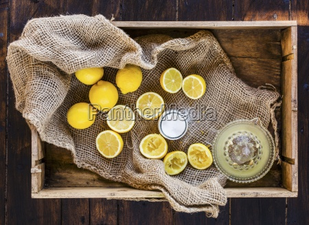 squeezing fresh lemons with sugar