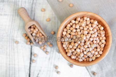 dried chickpeas in a wooden bowl
