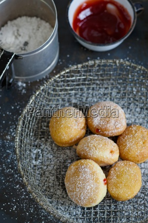 donuts in a wire basket a