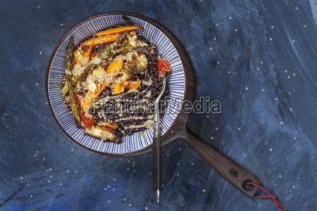 a vegan buddha bowl with black