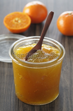 tangerine jam in a preserving jar