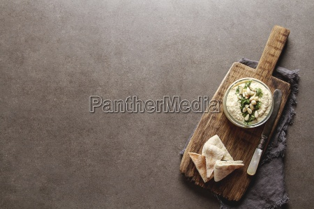 classic hummus with herbs olive oil