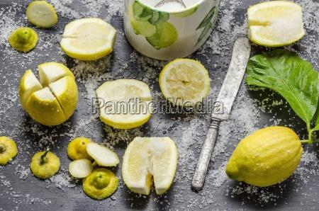 lemons being soaked in salt