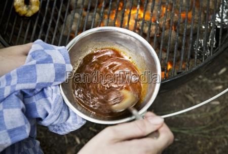 babi pangang sauce being heated on