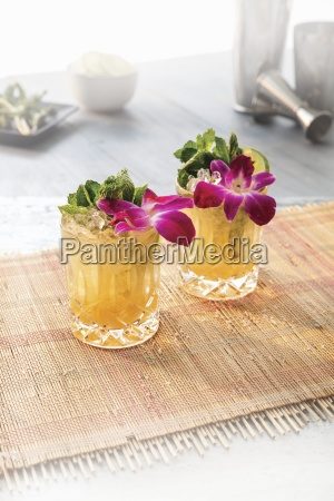 two mai tai cocktails garnished with