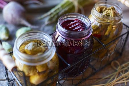 pickled vegetables in jars rose beetroot
