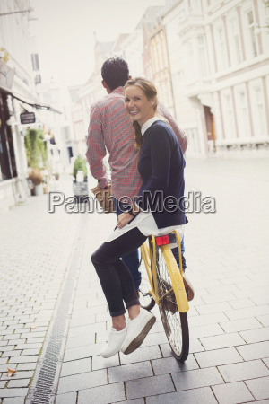 portrait smiling woman riding on back