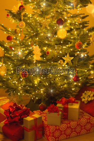 illuminated christmas tree with ornaments and