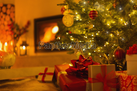 gifts under christmas tree in ambient