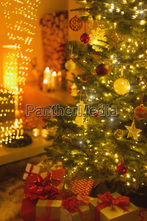 gifts under illuminated christmas tree