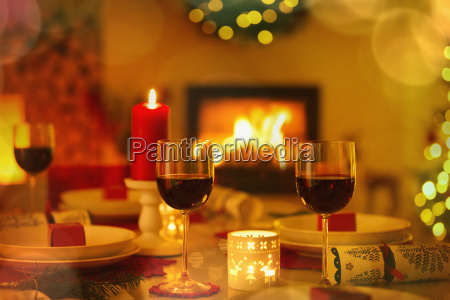 red wine and candles on ambient