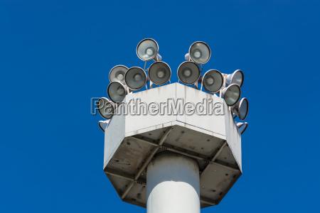 various megaphones on a high mast