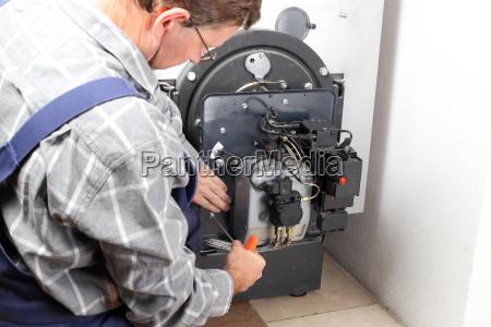 technician repairs heating